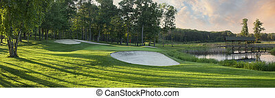 Panoramic view of golf green with white sand traps - Golf...