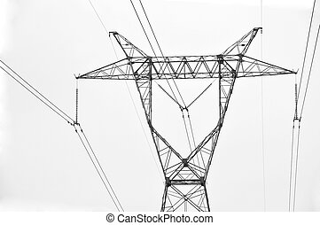 High voltage electricity cables datail over a clean sky