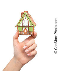 woman's hand holding a house