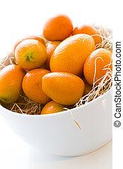 Kumquats - Organic kumquats on a white background.