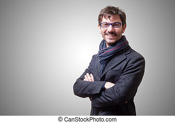 smiling casual business man with eyeglasses on gray...