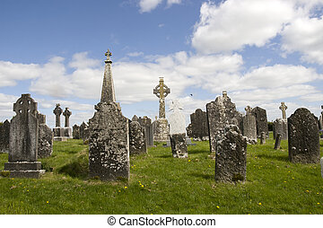 old ancient Celtic graveyard with unmarked gravestones in...