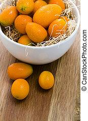 Kumquats - Organic kumquats in white bowl.