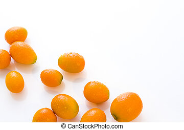 Kumquats - Organic kumquats on a white background.