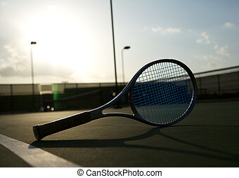 Tennis Racket Backlit by the Sun - Tennis Racket on the...