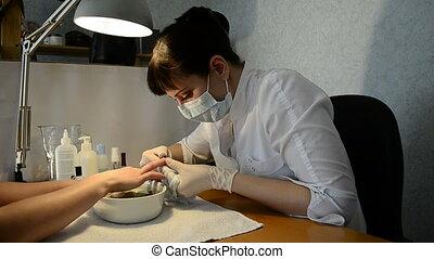 manicurist cut burrs client