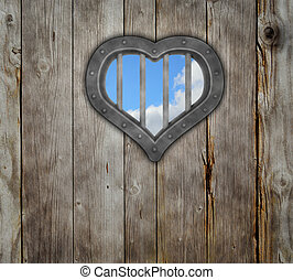 heart prison window on wooden planks background - 3d...