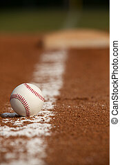 Baseball on the Infield Chalk Line with the Base in the...