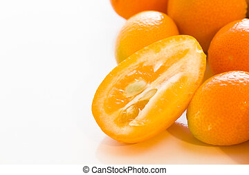 Kumquats - Organic kumquats on a white background