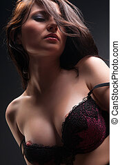 woman in bra - beautiful woman in bra on a dark background