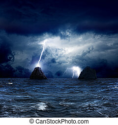 Two rocks in sea - Dramatic nature background - lightnings...