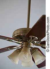 Ceiling Fan - Close up view of a ceiling fan with brown...