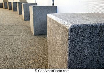 Concrete Blocks - A row of concrete blocks in the city