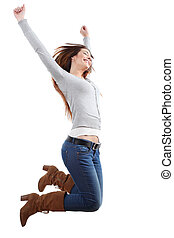 Teenager girl jumping happy with her arms raised on a white...