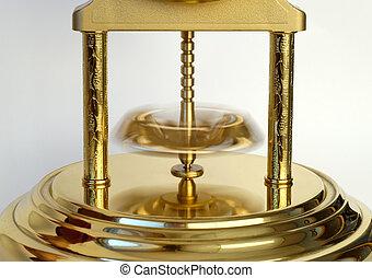 Rotating Pendulum - Rotating pendulum of a golden-coloured...
