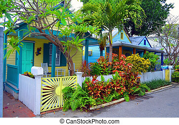 Colorful Key West Cottages - A row of wood frame cottages on...