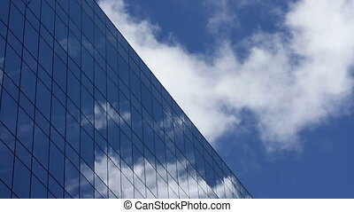 Clouds in Skyscraper Time Lapse - Time lapse, looking up at...