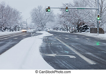 city street in winter weather - winter snowstorm on streets...