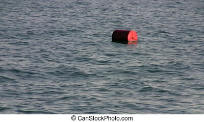 buoy bobs on the waves