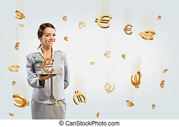 business woman holding a tablet with euro - attractive...