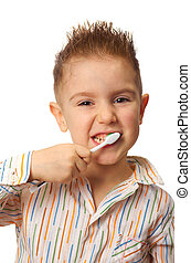 smiley boy cleans a teeth - Little child with dental...