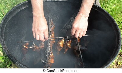 gourmet smoked fish - hand take smoked fish hang on shank in...