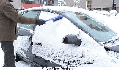 man remove snow car brush - man removing cleaning snow from...