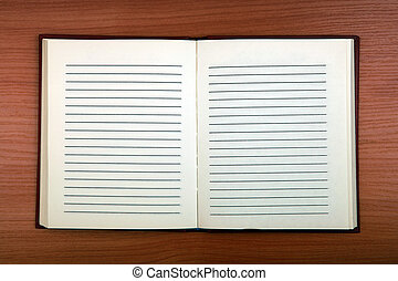 Blank Writing Pad on the Wooden Background