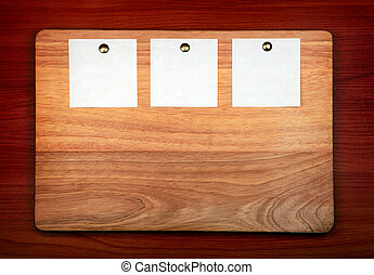 Notice Board with empty papers on old wooden wall background