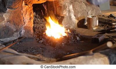 Blacksmith working in Canada