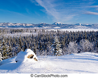 Scenic winter at frozen Lake Laberge Yukon Canada -...