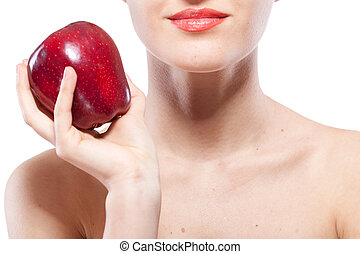 Portrait of smiling woman holding red apple isolated on white