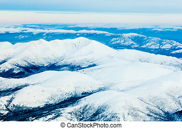 Aerial view of snowy winter mountains Yukon Canada - Aerial...