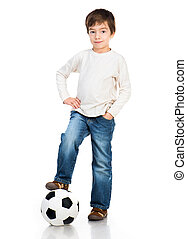 Little boy playing soccer ball isolated on white