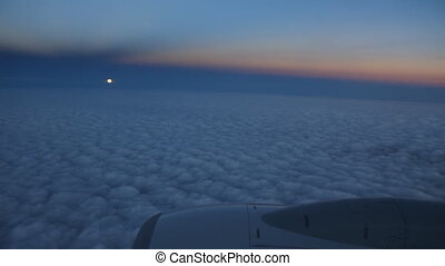 Passenger jet. View of Full moon. - Passenger jet in flight....