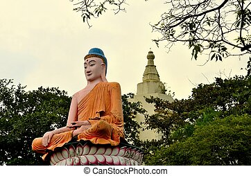 Meditating Buddha in lotus position - A large statue of a...