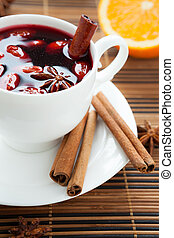 Traditional mulled wine with almonds and cinnamon, closeup