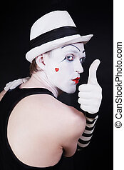 Theater actor with mime makeup on a black background