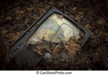 Old TV absolutely unnecessary. Lying in the street strewn...