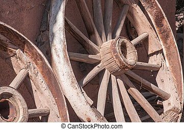 Old West Wagon Wheel otdoors under bright sunlight