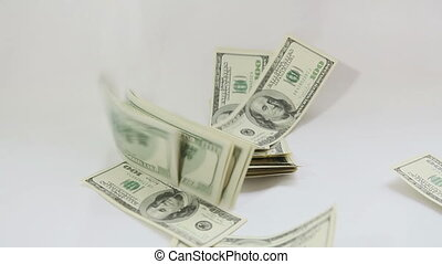 American dollars falling on white background
