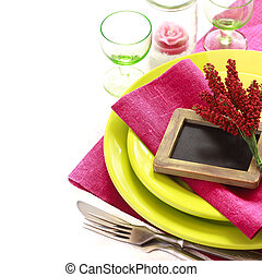 Table setting. - Table setting in green and purple colors...