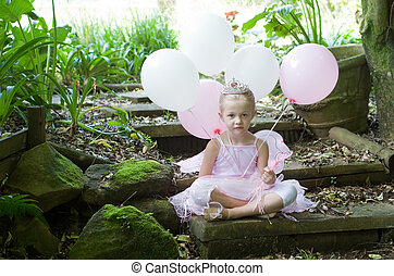 Little girl dressing up as a fairy-tale ballet princess on...