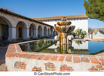 Mission San Miguel fountain - courtyard landscape of Mission...