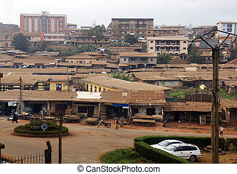 African city with typical little shops along the streets and...