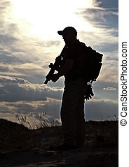 militant - private military contractor with rifle against...