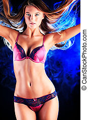chic look - Portrait of a sexual woman in lingerie over dark...