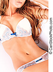 closeup bra - Sexual woman in white lingerie lying on a...