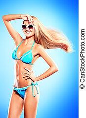 under the sun - Portrait of a romantic young woman in bikini...