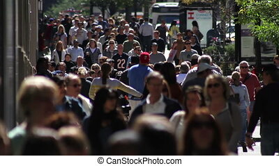 Crowded Sidewalk 2 - CHICAGO - A backlit crowd of people...